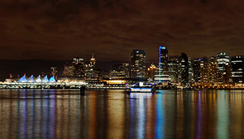 Vancouver Downtown at Night from Coal Harbour. Photo by Jason Mrachina. Licensed under CC BY 2.0